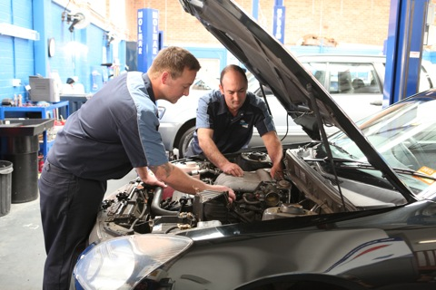 mechanics working on car